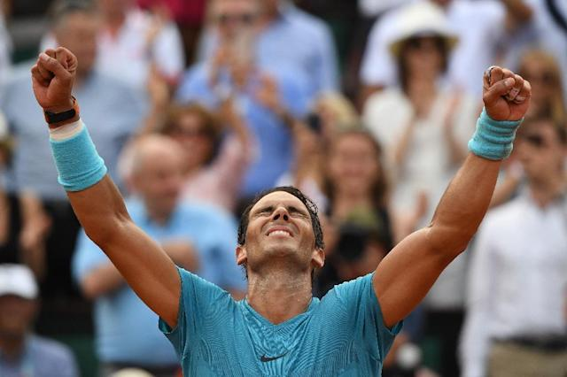 Man of the moment: Rafael Nadal celebrates his 11th title in Paris (AFP Photo/Christophe ARCHAMBAULT)