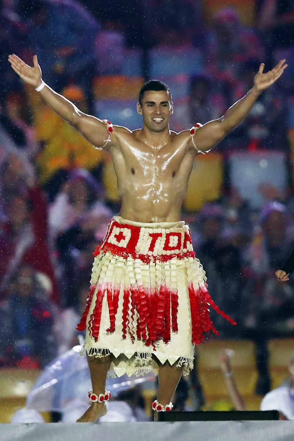 """<p>And while he is certainly a sight to behold, he's not just there to look pretty and carry a flag (though those things are a plus): Taufatofua was actually there to compete. </p> <p>And he wasn't <em>trying </em>to cause an Internet thirst trap, either. He told <a href=""""https://www.theguardian.com/sport/2019/jan/02/the-incredible-story-of-pita-taufatofua-tongas-shirtless-olympic-flag-bearer"""" rel=""""nofollow noopener"""" target=""""_blank"""" data-ylk=""""slk:The Guardian"""" class=""""link rapid-noclick-resp""""><em>The Guardian</em></a> in 2019, """"I was representing 1,000 years of history. We didn't have suits and ties when we traversed the Pacific Ocean.""""</p>"""