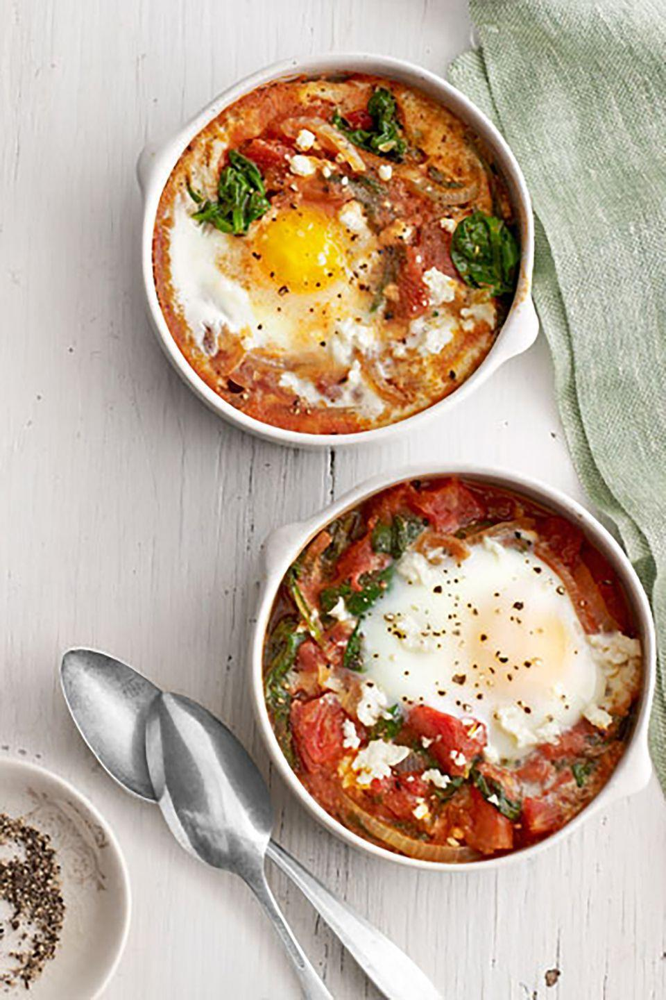 """<p>Nothing in the house but eggs, some canned tomatoes, and maybe a little cheese? Break out the frozen spinach and whip this up.</p><p><strong><a href=""""https://www.countryliving.com/food-drinks/recipes/a4148/baked-eggs-spinach-tomato-recipe-clv0313/"""" rel=""""nofollow noopener"""" target=""""_blank"""" data-ylk=""""slk:Get the recipe"""" class=""""link rapid-noclick-resp"""">Get the recipe</a>.</strong></p><p><strong><a class=""""link rapid-noclick-resp"""" href=""""https://www.amazon.com/Sweejar-Ceramic-Souffle-Ramekins-Custard/dp/B07TZQYMMH/?tag=syn-yahoo-20&ascsubtag=%5Bartid%7C10050.g.32969162%5Bsrc%7Cyahoo-us"""" rel=""""nofollow noopener"""" target=""""_blank"""" data-ylk=""""slk:SHOP RAMEKINS"""">SHOP RAMEKINS</a><br></strong></p>"""