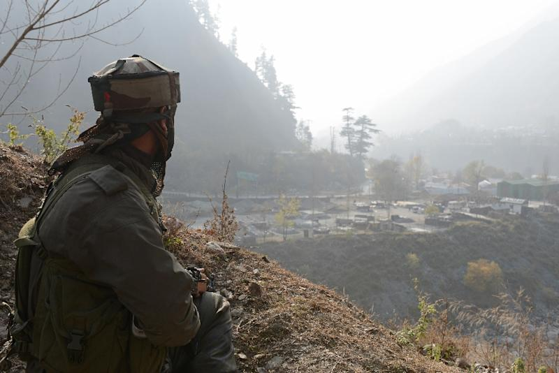 An Indian soldier keeps watch from his position near the Line of Control (LoC) -- the heavily militarised border that divides Kashmir between India and Pakistan -- in Gingal Uri, on December 5, 2014