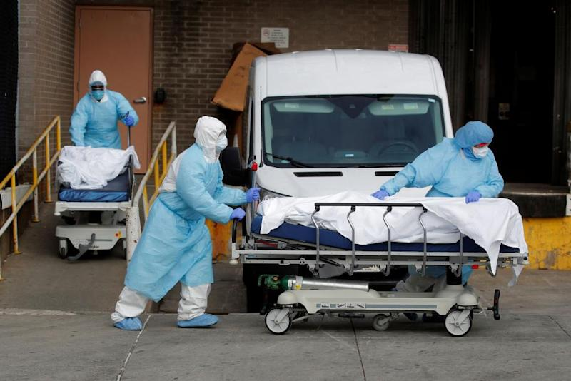 Healthcare workers wheel the bodies of deceased people from the Wyckoff Heights Medical Center during the outbreak of the coronavirus disease (COVID-19) in the Brooklyn borough of New York City.