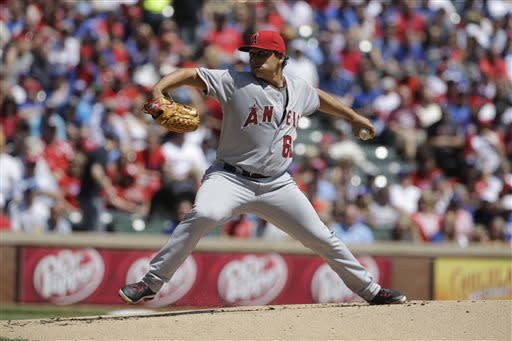 Los Angeles Angels' Jason Vargas delivers to the Texas Rangers in the first inning of a baseball game Friday, April 5, 2013, in Arlington, Texas. (AP Photo/Tony Gutierrez)