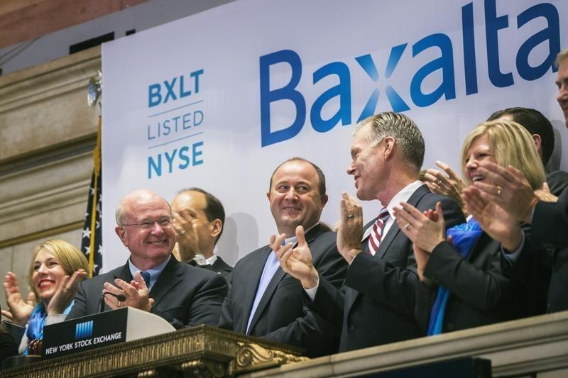 Hantson, Chief Executive Officer of Baxalta, celebrates the company's IPO after ringing the opening bell above the floor of the New York Stock Exchange