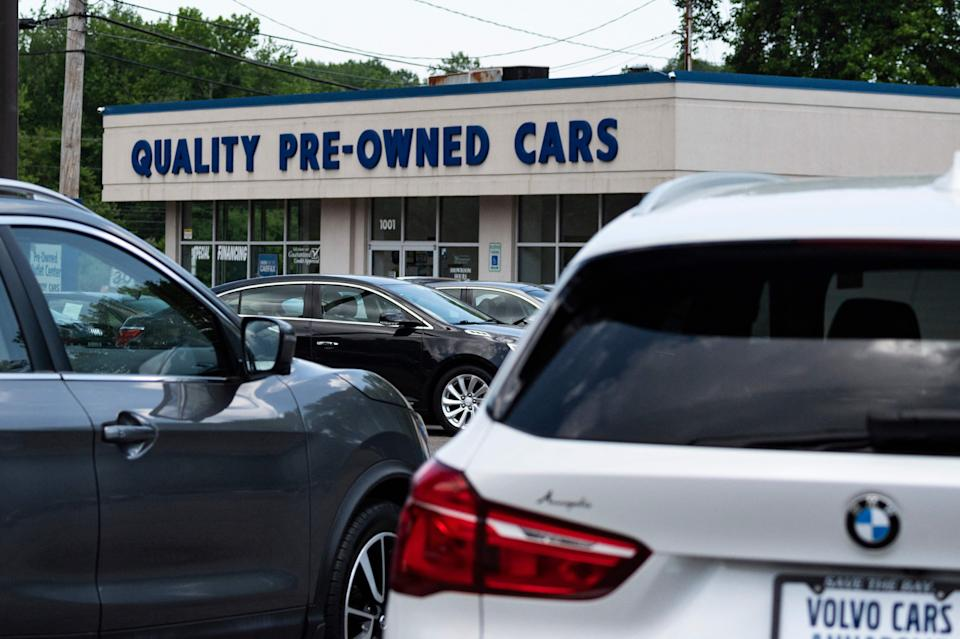 A used car dealership is seen in Annapolis, Maryland on May 27, 2021, as many car dealerships across the country are running low on new vehicles as a computer chip shortage has caused production at many vehicle manufactures to nearly stop. (Photo by JIM WATSON / AFP) (Photo by JIM WATSON/AFP via Getty Images)