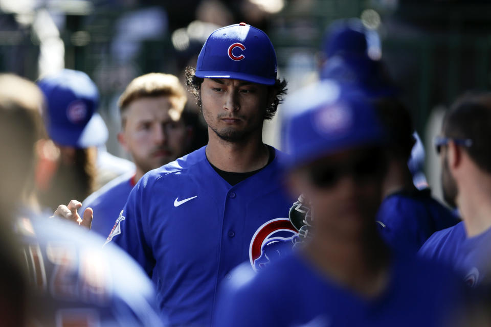 Chicago Cubs starting pitcher Yu Darvish is greeted in the dugout during the second inning of a spring training baseball game against the Milwaukee Brewers, Saturday, Feb. 29, 2020, in Mesa, Ariz. (AP Photo/Gregory Bull)