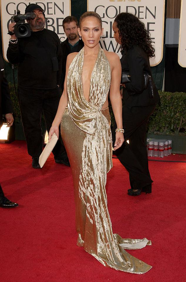 Jennifer Lopez was literally golden in a plunge-necked, draped gown by Marchesa. Description: BEVERLY HILTON, CA - JANUARY 11: Actress Jennifer Lopez arrives at the 66th Annual Golden Globe Awards held at the Beverly Hilton Hotel on January 11, 2009 in Beverly Hills, California. (Photo by Jason Merritt/Getty Images) *** Local Caption *** Jennifer Lopez Rights: 2009 Getty Images Title: 56470675 Creator: Jason Merritt CaptionWriter: tm Credit: Getty Images Source: Getty Images North America