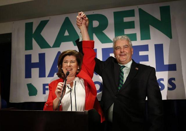 Republican candidate for Georgia's Sixth Congressional District Karen Handel celebrates with her husband, Steve, as she declares victory during an election-night watch party, June 20, 2017, in Atlanta. (Photo: John Bazemore/AP)