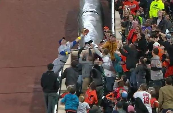 Steve Pearce of the Blue Jays dives into the stands to make a crazy catch against the Orioles. (MLB.TV)