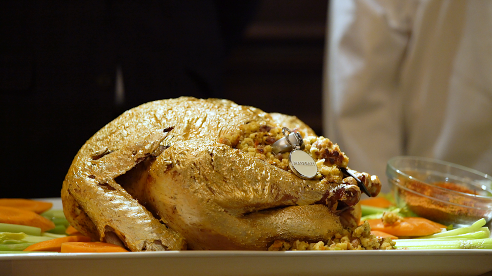 The Old Homestead $150,000 Thanksgiving dinner features options for gold turkeys: one sprinkled with gold flakes, or edible gold paint like this one stuffed with keys to a Maserati.