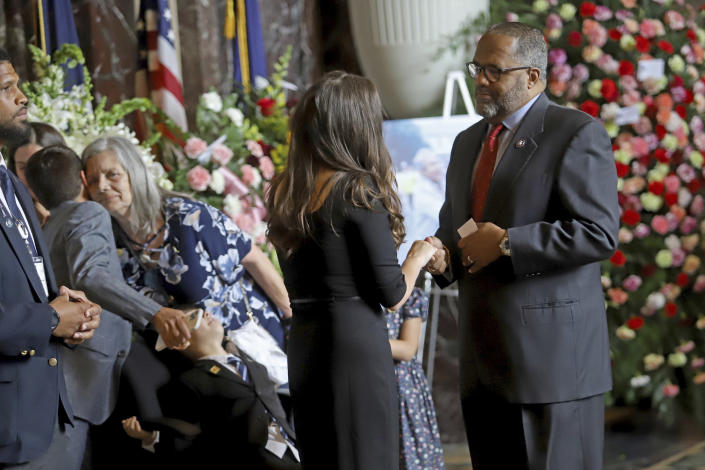 Edwin W. Edwards' daughter Anna is embraced at left while Edwards' wife Trina speaks with U.S. Representative for Louisiana's 2nd District Troy Carter as the former Louisiana Governor lies in state in Memorial Hall of the Louisiana State Capitol in Baton Rouge, La., Saturday, July 17, 2021. The colorful and controversial four-term governor died of a respiratory illness on Monday, July 12. (AP Photo/Michael DeMocker)