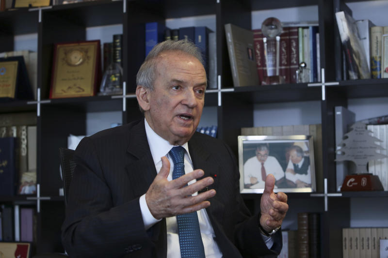 FILE - In this picture taken on Wednesday, Feb. 4, 2015, Marwan Hamadeh, a leading Lebanese legislator and former Cabinet minister who was close to Hariri, speaks during an interview in Beirut, Lebanon. The Special Tribunal for Lebanon, a U.N.-backed court based in the Netherlands, on Monday, Sept. 16, 2019, filed new charges including terrorism and intentional homicide against Salim Jamil Ayyash, a Hezbollah fighter who also is accused of assassinating former Lebanese Prime Minister Rafiq Hariri. The new indictment accuses Ayyash of three bombings on Oct. 1, 2004, June 21 and July 12, 2005, each targeting a different politician — Marwan Hamadeh, Georges Hawi and Elias El-Murr. (AP Photo/Bilal Hussein, File)
