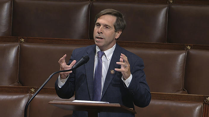 Rep. Chuck Fleischmann gestures with his hands while speaking into a microphone
