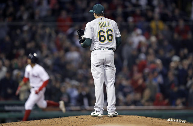 Oakland Athletics relief pitcher Ryan Dull (66) waits for Boston Red Sox's Xander Bogaerts to run the bases on a three-run home run during the sixth inning of a baseball game at Fenway Park in Boston, Wednesday, May 16, 2018. (AP Photo/Charles Krupa)