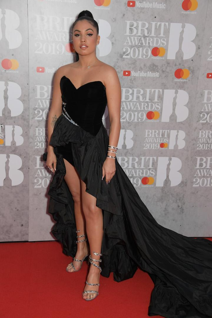 <p>Wearing a cold-shoulder dress. [Photo: Getty] </p>