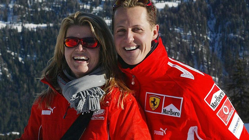 Michael Schumacher poses with his wife Corinna in Northern Italy, 11 January 2005. AFP PHOTO / Press Ferrari (Photo credit should read STR/AFP/Getty Images)
