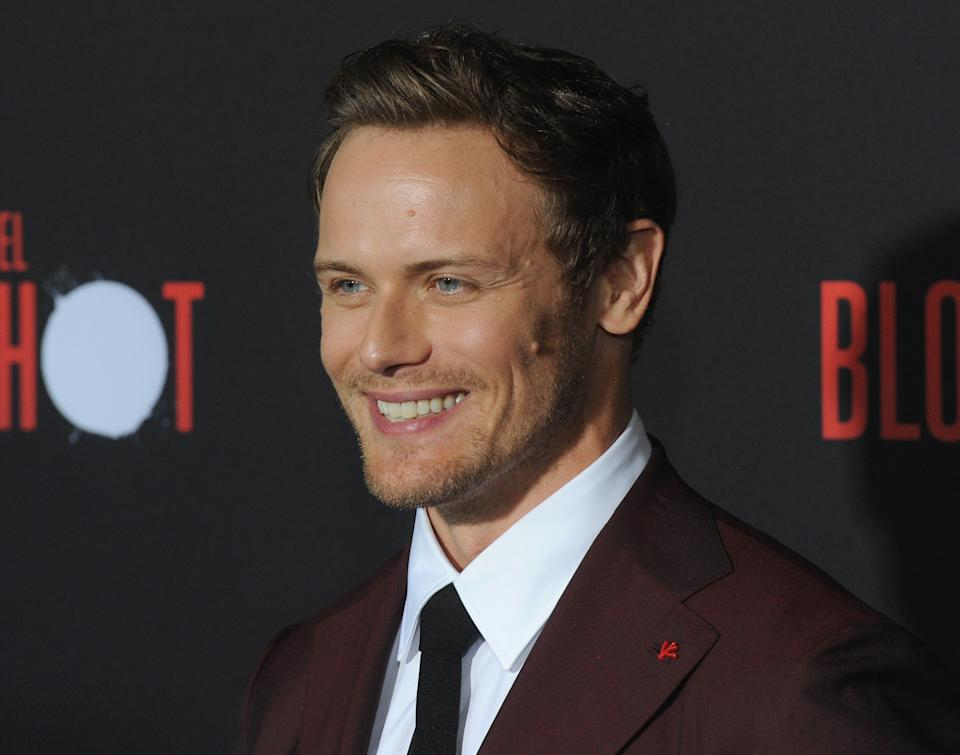 """LOS ANGELES, CA - MARCH 10:  Sam Heughan arrives for the Premiere Of Sony Pictures' """"Bloodshot""""  held at The Regency Village on March 10, 2020 in Los Angeles, California.  (Photo by Albert L. Ortega/Getty Images)"""