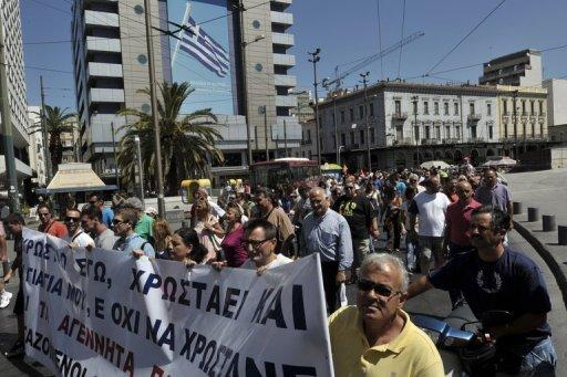 Municipal workers march in central Athens on Wednesday as part of a 48-hours strike protesting spending cutbacks and the government's latest austerity measures. The Greek Prime minister's coalition partners are balking at planned cuts to pensions and benefits, and reductions in the pay of army and police staff