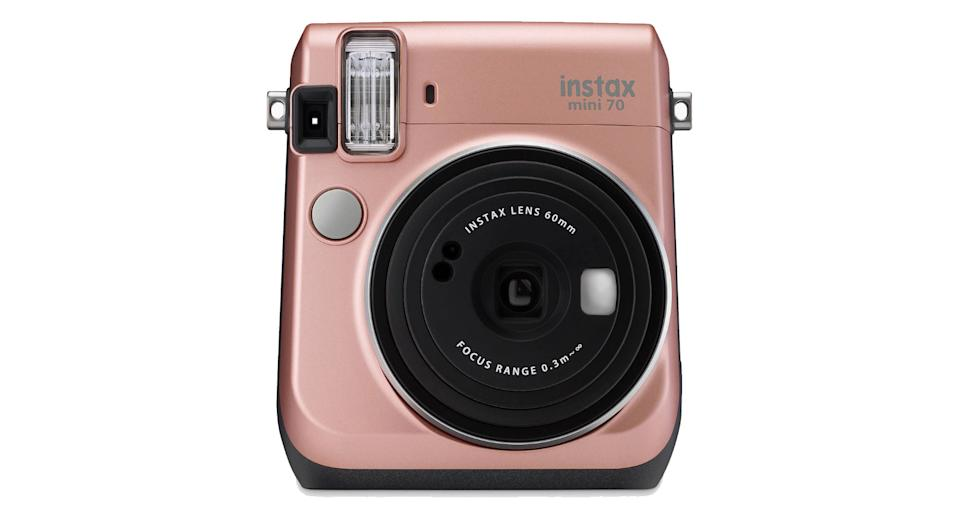"""If you miss the good old days of instant photos, this 60mm, ISO 800m lens camera will allow you to take stunning snaps and have them printed within minutes. It also features a focused selfie mode that delivers crisp results when you self-snap. <a href=""""http://www.awin1.com/cread.php?awinaffid=580847&awinmid=1203&clickref=christmas-tech&platform=dl&p=%5B%5Bhttps%3A%2F%2Fwww.johnlewis.com%2Ffujifilm-instax-mini-70-instant-camera-with-10-shots-of-film-selfi-mode-built-in-flash-hand-strap-rose-gold%2Fp3350229%5D%5D"""" rel=""""nofollow noopener"""" target=""""_blank"""" data-ylk=""""slk:Shop now"""" class=""""link rapid-noclick-resp""""><strong>Shop now</strong></a><strong>.</strong>"""