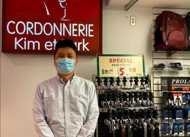 Wan Hyun Kim is among store owners who learned back in November that they will have to move out of Le Boulevard shopping centre. (Simon Nakonechny/CBC - image credit)