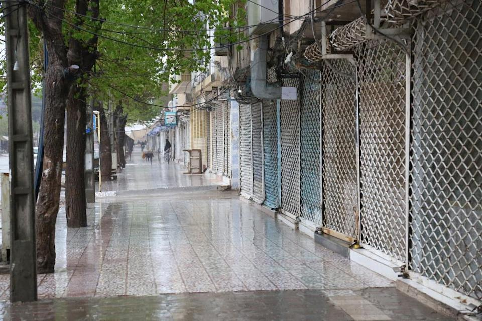 Closed shops are seen after a curfew imposed in Herat, Afghanistan on 25 March, 2020.