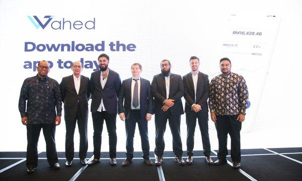 L to R - Mohd Izzat Fadhli, Country Director, Wahed Invest, Mohd Yuzaidi Mohd Yusoff, Non-Executive Independent Director, MDeC, Junaid Wahedna, Founder and Chief Executive Officer of Wahed Invest, Linar Yakupov, Advisor, Wahed Invest, As'ad Layth, VP of Business Development, Wahed Invest, Kareem Tabaa, Chief Product Officer, Wahed Invest and Syakir Hashim, Regional Head of APAC, Wahed Invest at the Wahed Invest Malaysia Launch