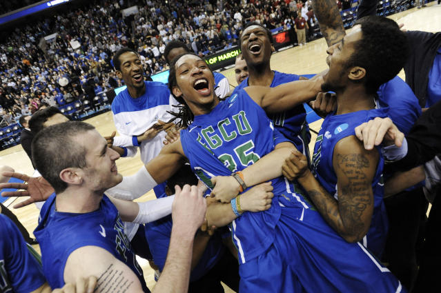 FILE - In this March 24, 2013, file photo, Florida Gulf Coast's Sherwood Brown, center, celebrates with teammates after their 81-71 win over San Diego State in a third-round game in the NCAA college basketball tournament in Philadelphia. The team's leading scorer and Atlantic Sun player of the year who received honorable mention for the AP All-America team — Sherwood Brown got seven NBA tryouts before beginning his pro career overseas. Without Dunk City, NBA teams probably wouldn't have taken notice of the player who showed up at FGSU as an unrecruited walk-on. (AP Photo/Michael Perez, File)