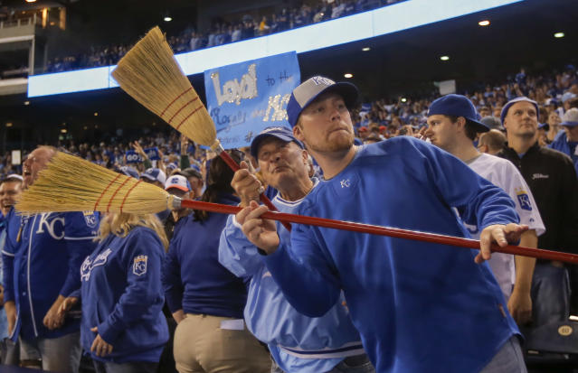 Kansas City Royals fans hold brooms following Game 3 of baseball's AL Division Series in Kansas City, Mo., Sunday, Oct. 5, 2014. The Kansas City Royals defeated the Los Angeles Angels 8-3 to sweep the series. (AP Photo/Travis Heying)