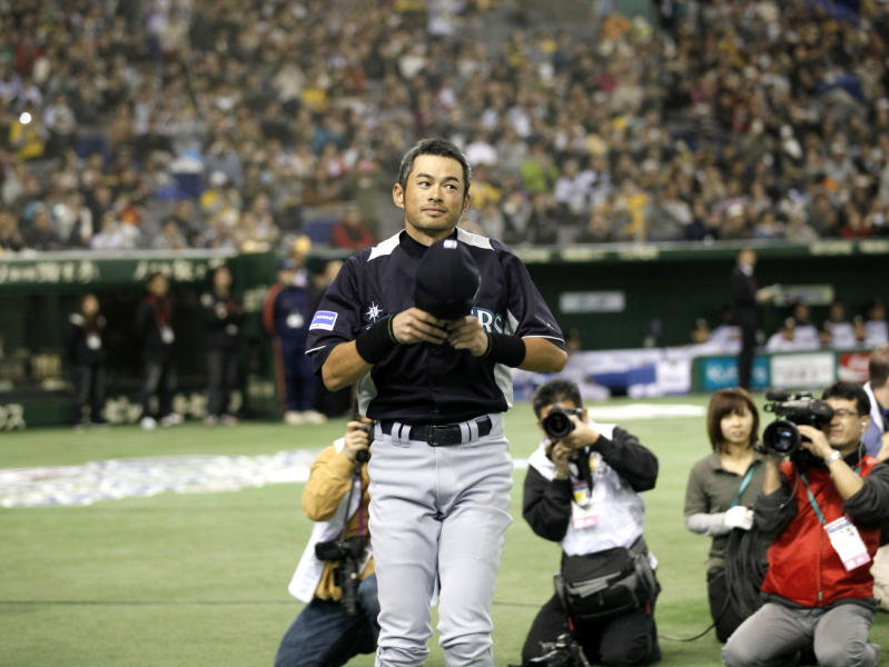 Seattle Mariners outfielders Ichiro Suzuki greets spectators during the opening ceremony of an exhibition baseball game against Japan's Hanshin Tigers at the Tokyo Dome in Tokyo Sunday, March 25, 2012. The Mariners will meet the Oakland Athletics in their two season-opening baseball games of the major league in Japan, at the Tokyo Dome from Wednesday. (AP Photo/Koji Sasahara)