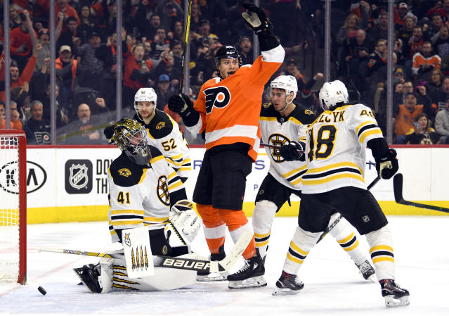 Philadelphia Flyers' Connor Bunnaman, center, celebrates after scoring a goal past Boston Bruins goaltender Jaroslav Halak, left, during the second period of an NHL hockey game, Monday, Jan. 13, 2020, in Philadelphia. (AP Photo/Derik Hamilton)