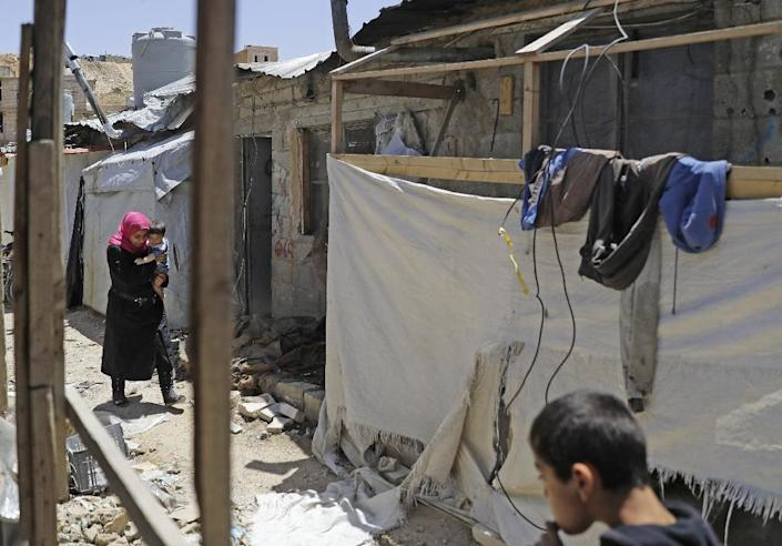 Rubble has started to fill the narrow alleyways of the crowded camp (AFP Photo/JOSEPH EID)