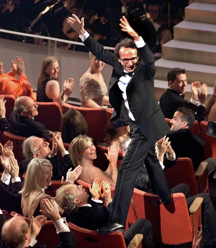"Roberto Benigni's award show moment started before he even got to the microphone. After it was announced that ""Life Is Beautiful"" won the Oscar for Best Foreign Film in 1999, Benigni started walking across the tops of other guests' seats as he celebrated. The antics led to a spoof on ""Saturday Night Live,"" with Ray Romano playing an excitable Benigni crawling over patrons at a restaurant."