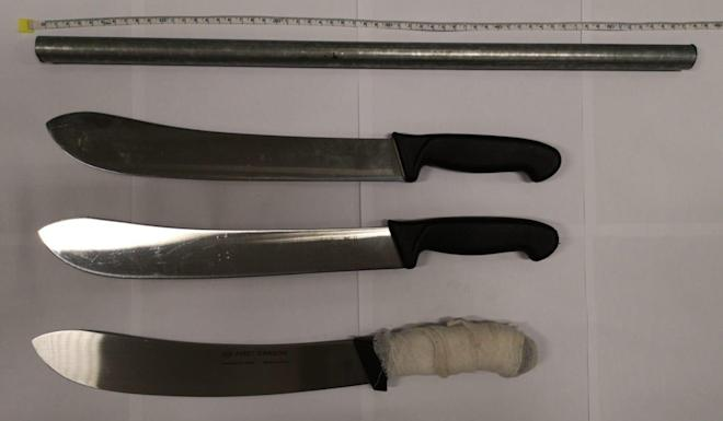 Police also found an axe, four knives and a metal rod in the car. Photo: Handout