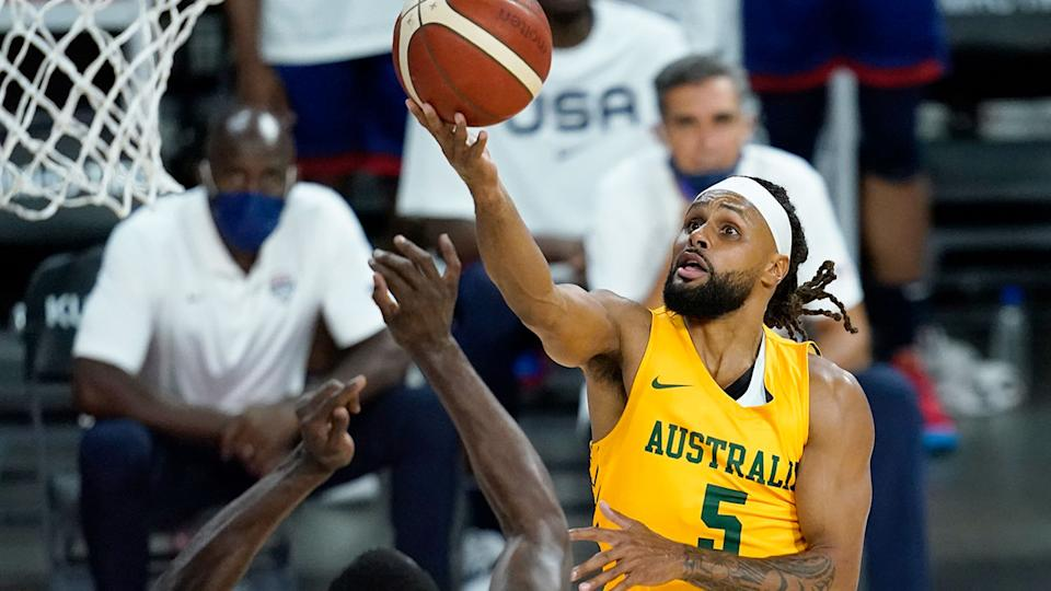 Patty Mills is seen here scoring a basket against Team USA.