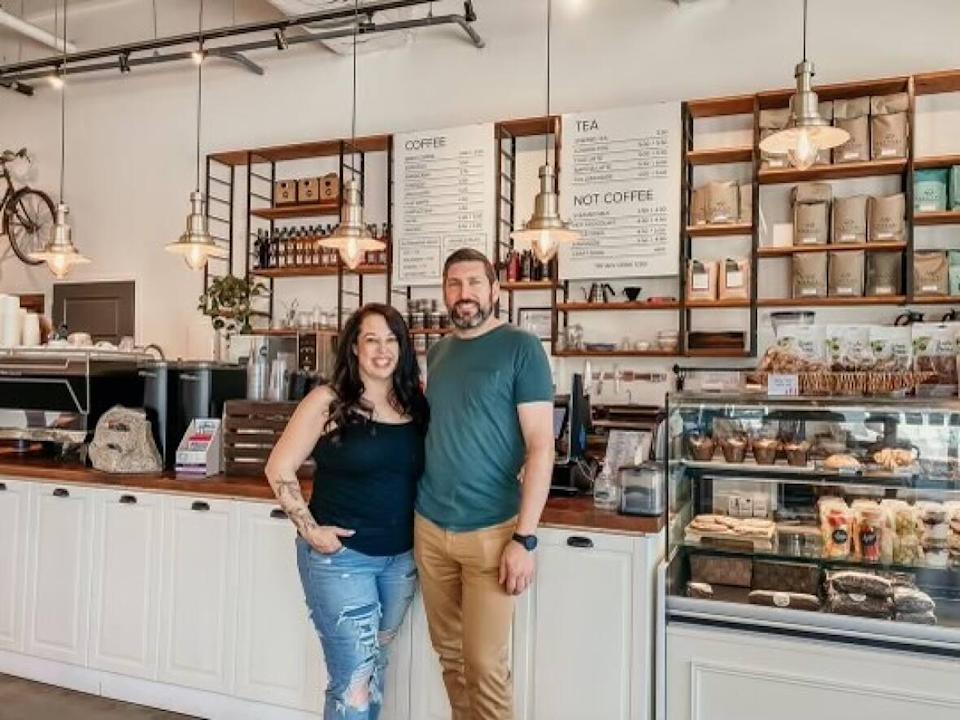 Square 1 Coffee co-owners Brandy and Jonathon Bronzy chose not to participate in the province's restriction exemption program, opting to keep their two locations takeout only.  (Katie Samycia - image credit)