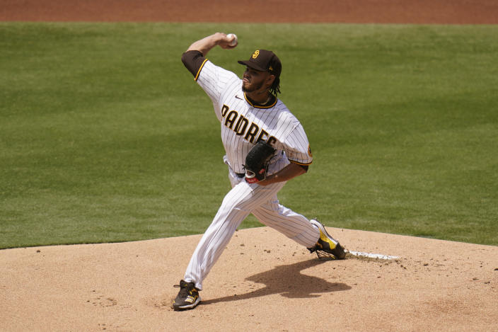 San Diego Padres starting pitcher Dinelson Lamet works against a Milwaukee Brewers batter during the first inning of a baseball game Wednesday, April 21, 2021, in San Diego. (AP Photo/Gregory Bull)