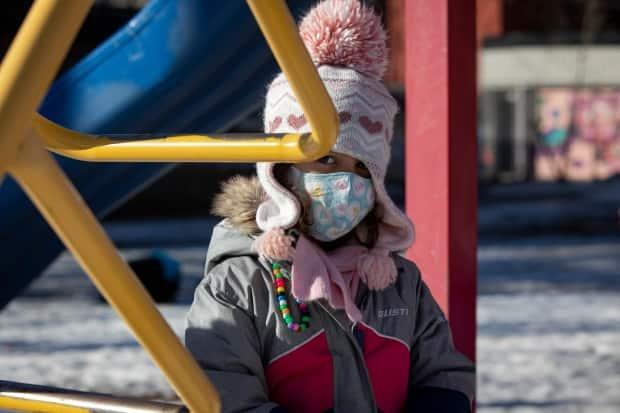 A kindergarten student in Toronto is pictured wearing a mask in the playground in February. (Evan Mitsui/CBC - image credit)