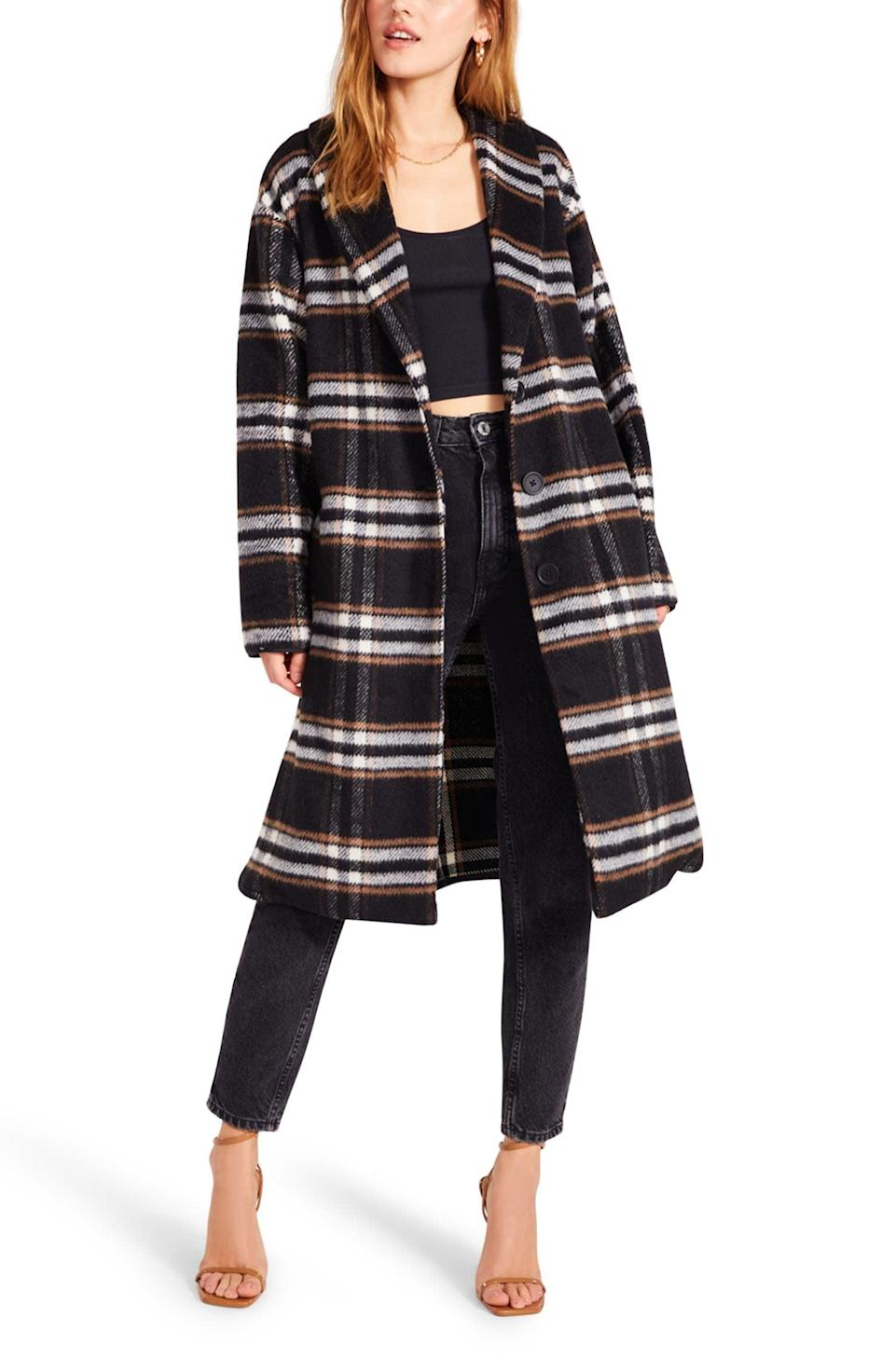 """<p>""""Long walks down the street for a hot chocolate or a PSL with extra cinnamon would be so much cozier in this <span>BB Dakota by Steve Madden Shawl Good Plaid Longline Coat</span> ($139). Perfect for layering, the dark plaid pattern makes it easy to pair with virtually any outfit - and it has pockets!"""" - CV</p>"""