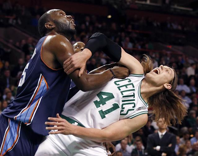 Charlotte Bobcats center Al Jefferson, left, fights for position on a rebound with Boston Celtics center Kelly Olynyk (41) in the first quarter of an NBA basketball game in Boston, Wednesday, Nov. 13, 2013. (AP Photo/Elise Amendola)