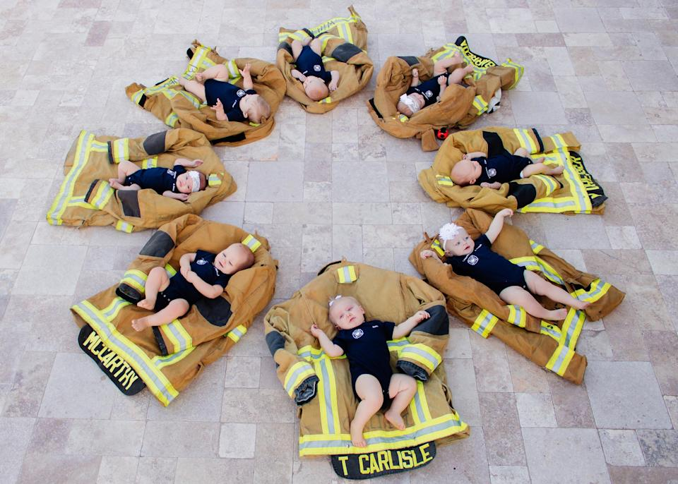 When a bunch of Phoenix firefighters realized they were expecting at the same time, they arranged a photo shoot that's now going viral. (Photo: Wildbird Photography)