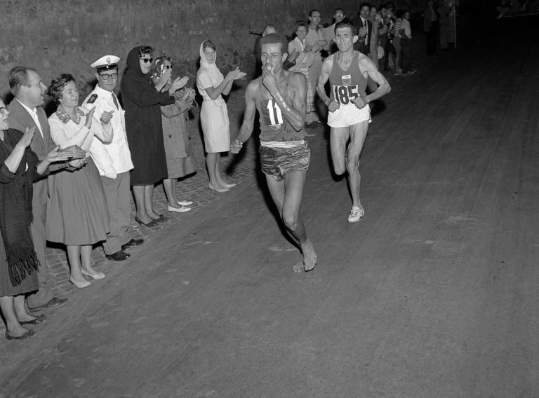 Ethiopian runner Abebe Bikila borje the marathon world record in winning gold in the 1964 Games in Rome....running without shoes