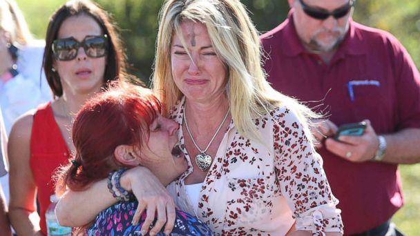 PHOTO: Women embrace in a waiting area for parents of students after a shooting at Marjory Stoneman Douglas High School in Parkland, Fla., Feb. 14, 2018. (Joel Auerbach/AP)