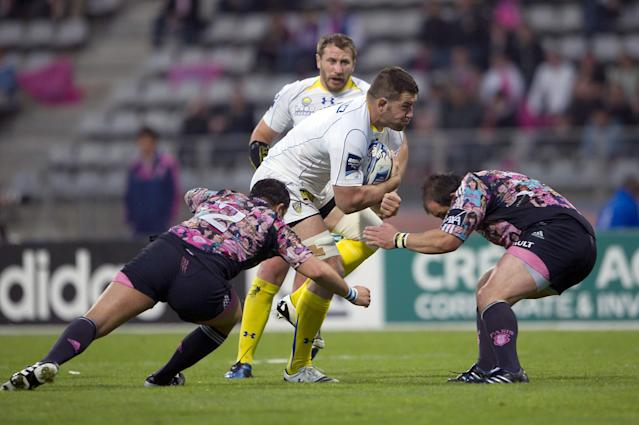 Clermont's number 8 Elvis Vermeulen (C) vies with Stade Francais' hooker Laurent Sempere (L) and prop David Attoub during the European Challenge Cup semi final rugby union match Stade Francais vs. Clermont at the Charlety stadium in Paris on April 29, 2011. AFP PHOTO / BERTRAND LANGLOIS (Photo credit should read BERTRAND LANGLOIS/AFP/Getty Images)