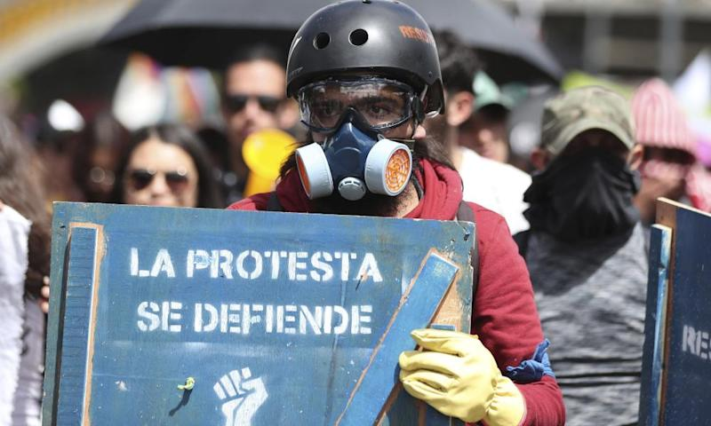 An anti-government demonstrator during a national strike in Bogotá, Colombia, 4 December 2019.