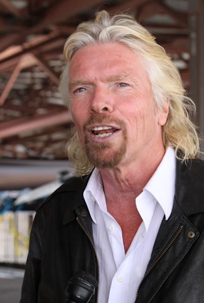 FILE - In this Oct. 22, 2010, file photo, British billionaire and Virgin Galactic founder Sir Richard Branson talks at Spaceport America in Upham, N.M. With Spaceport nearly complete but still mostly empty, Branson and Virgin Galactic has hinted it may take its spacecraft and launch elsewhere. (AP Photo/Susan Montoya Bryan)