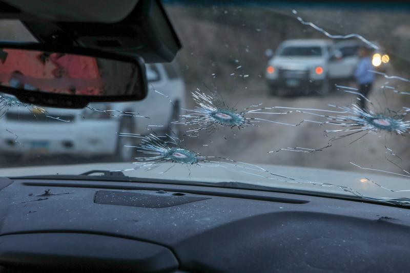 Bullet holes are seen in a car which was shot at by Mexican drug cartel.