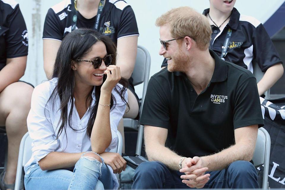 <p>The adorable couple shared a joke while attending an Invictus Games Toronto event in September 2017, months before the Prince got down on one knee for Markle. </p>