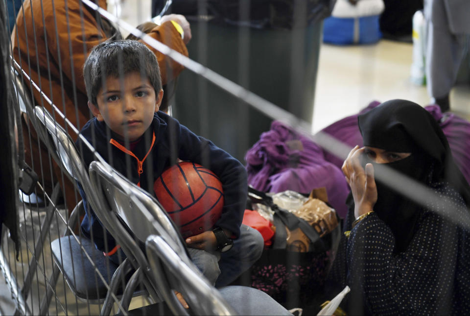 Afghan refugees are processed inside Hangar 5 at the Ramstein U.S. Air Base in Germany Wednesday, Sept. 8, 2021. U.S. Secretary of State Antony Blinken arrived at the base where he will meet with his German counterpart for talks on Afghanistan. (Olivier Douliery/Pool Photo via AP)