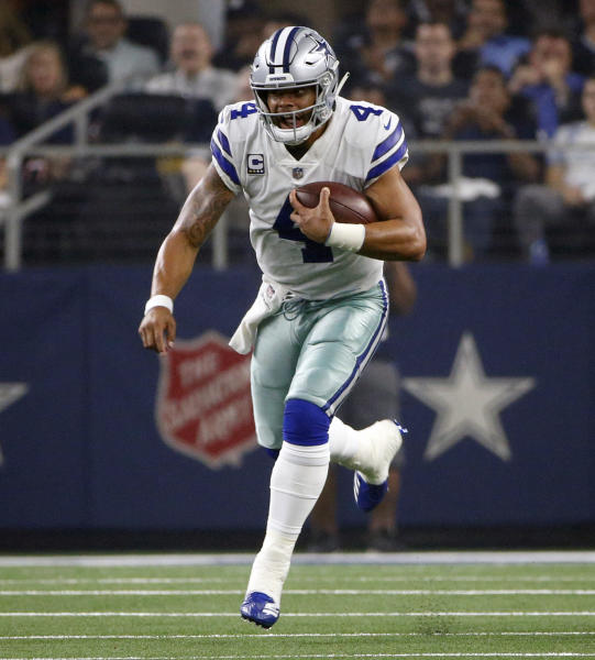FILE - In this Sept. 16, 2018, file photo, Dallas Cowboys quarterback Dak Prescott (4) scrambles for yards against the New York Giants during the first half of an NFL football game, in Arlington, Texas. After having one the worst run defense in the NFL last season, the Washington Redskins have improved in that area enough that they go into a matchup against the Dallas Cowboys feeling confident they can contain Ezekiel Elliott and Dak Prescott. (AP Photo/Ron Jenkins, File)