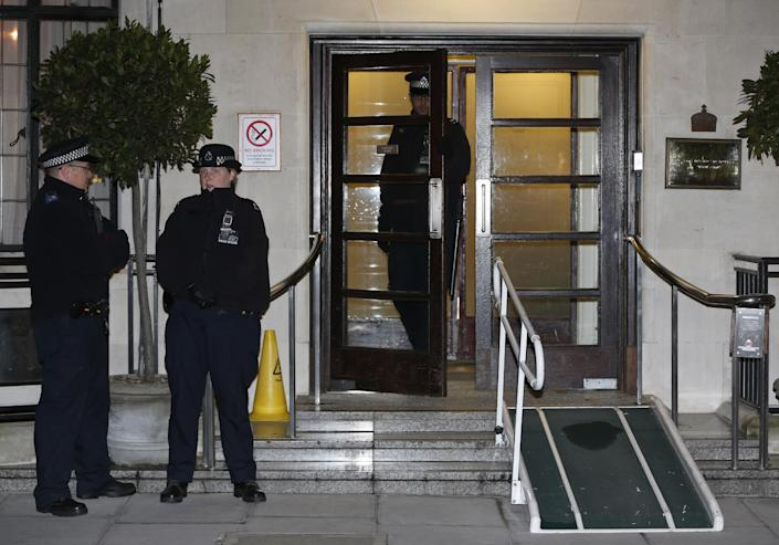 Police officers stand guard outside the King Edward VII hospital, in central London, Friday, Dec. 7, 2012. King Edward VII hospital says a nurse involved in a prank telephone call to elicit information about the Duchess of Cambridge has died. The hospital said Friday that Jacintha Saldanha had been a victim of the call made by two Australian radio disc jockeys. They did not immediately say what role she played in the call. (AP Photo/Lefteris Pitarakis)
