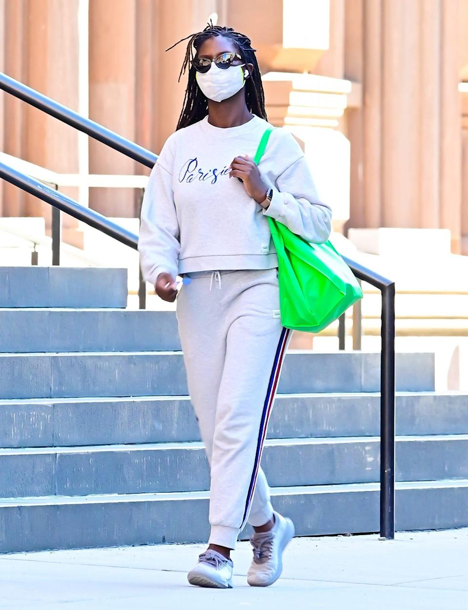 <p>Jodie Turner-Smith wears a comfy sweatsuit and a neon green bag while out in N.Y.C. on Tuesday.</p>